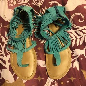 Aqua Minnetonka leather fringed thong sandals
